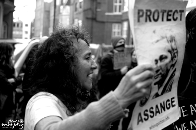 Protesters showing their support for Julian Assange at the Ecuadorian Embassy
