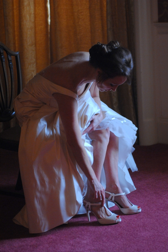 Paula getting ready - putting her shoes on in her suite at Luton Hoo