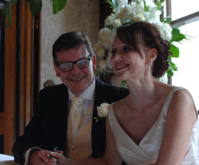 Paula and Mike signing the register at Luton Hoo